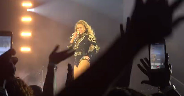 Queen Bey pauses to look for a volunteer.