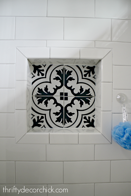 Niche in shower with cement tile