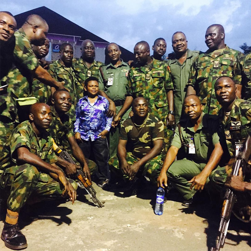 Osita Iheme poses with group of soldiers, gets new title