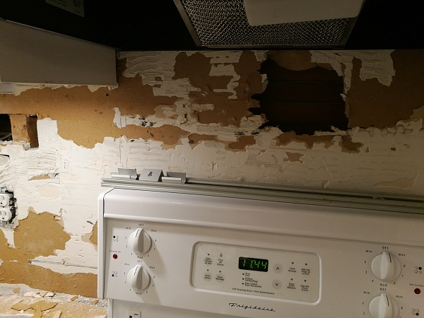 Damaged drywall in a kitchen