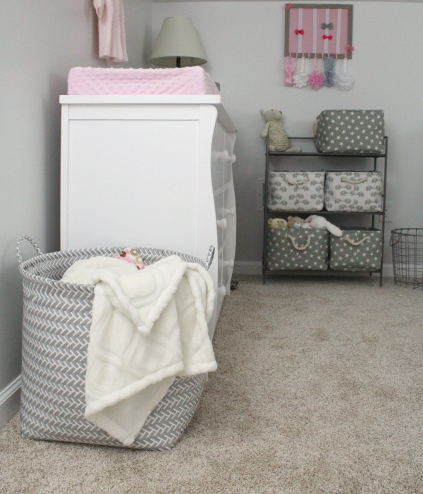Pink and gray nursery for baby girl- huge gray and white blanket basket from Target