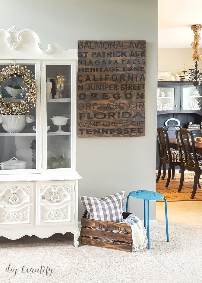 antiqued crate for hidden storage | diy beautify
