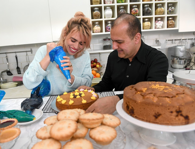 Billie Piper helps owner Lorenzo Khan bake cakes at her local favourite shop