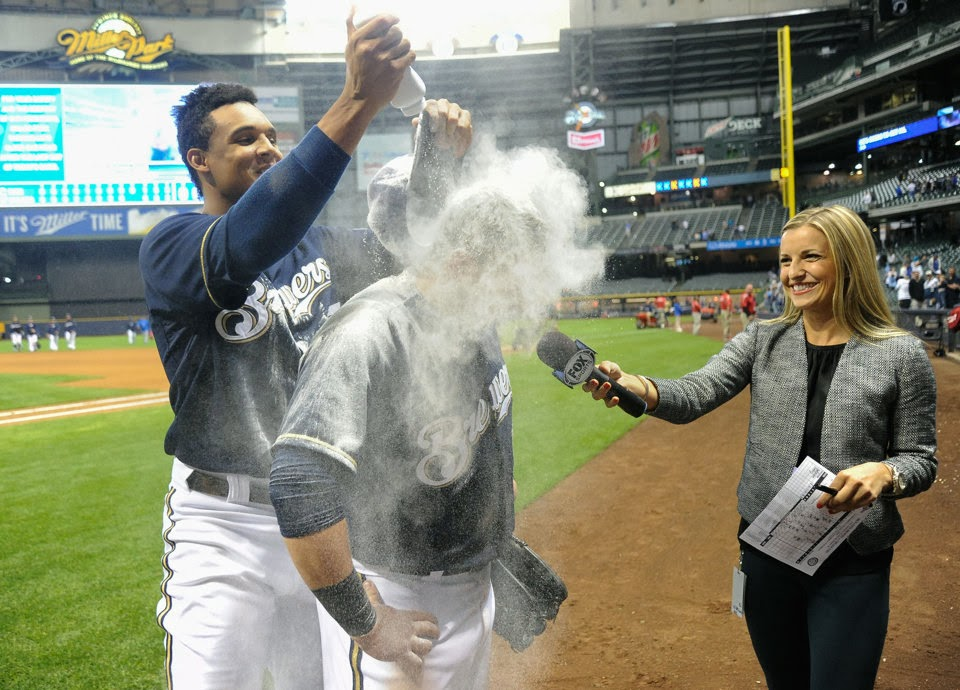 Caleb Gindl is doused with powder alongside Sophia Minnaert