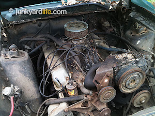 2-barrell carburetor and stock everything under the hood.