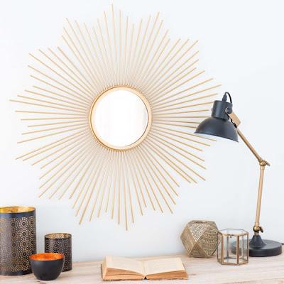 http://www.maisonsdumonde.com/ES/es/produits/fiche/espejo-redondo-de-metal-dorado-d-70-cm-soledad-159514.htm