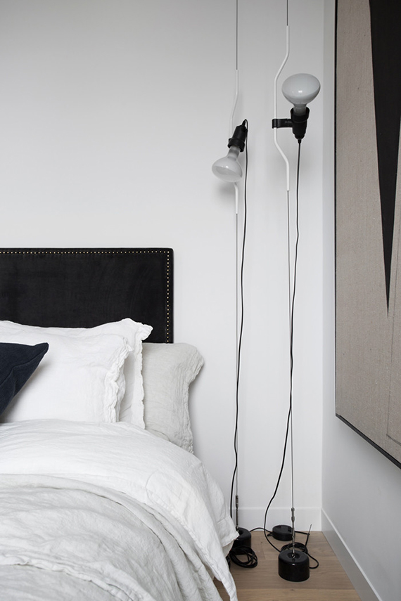 The Parentesi Lamp used as a bedside lighting in the bedroom | Residence Magazine