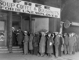 A long line of people standing for free food and coffee during Great Depression