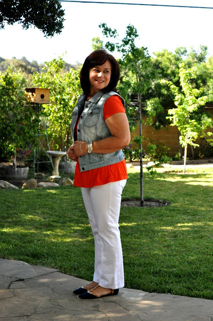 white jeans and a denim vest