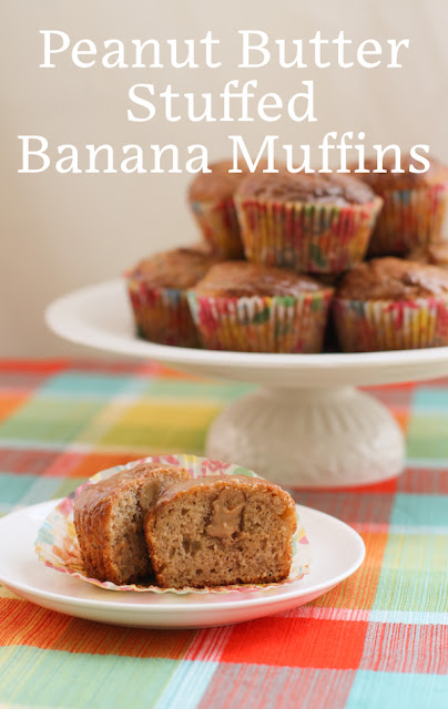 Food Lust People Love: Peanut butter stuffed banana muffins are baked with our favorite banana batter filled with a good teaspoon of peanut butter each, then dipped in a sweet peanut butter glaze. These guys are a special treat for breakfast, snack time or even dessert.
