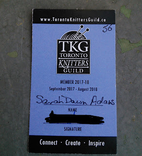 Image of the 2017-2018 Toronto Knitter's Guild Membership.  It has the TKG website (www.torontoknittersguild.ca) across the top of the card.  TThe centre of the card has the TKG Logo.  The bottom of the card has a Name and Signature Space.  Name reads: Sarah Dawn Adams.  Signature has been blacked out.