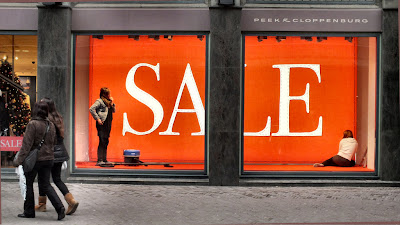 Huge SALE sign in store window