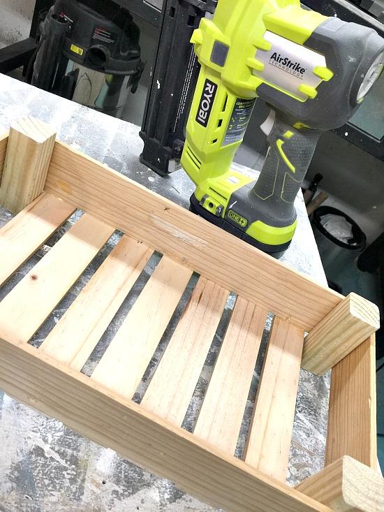 Wooden crate and nail gun