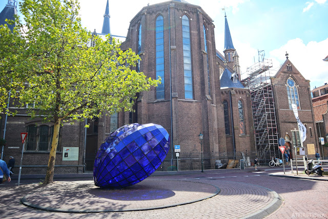 Blue gem artwork delft behind new church