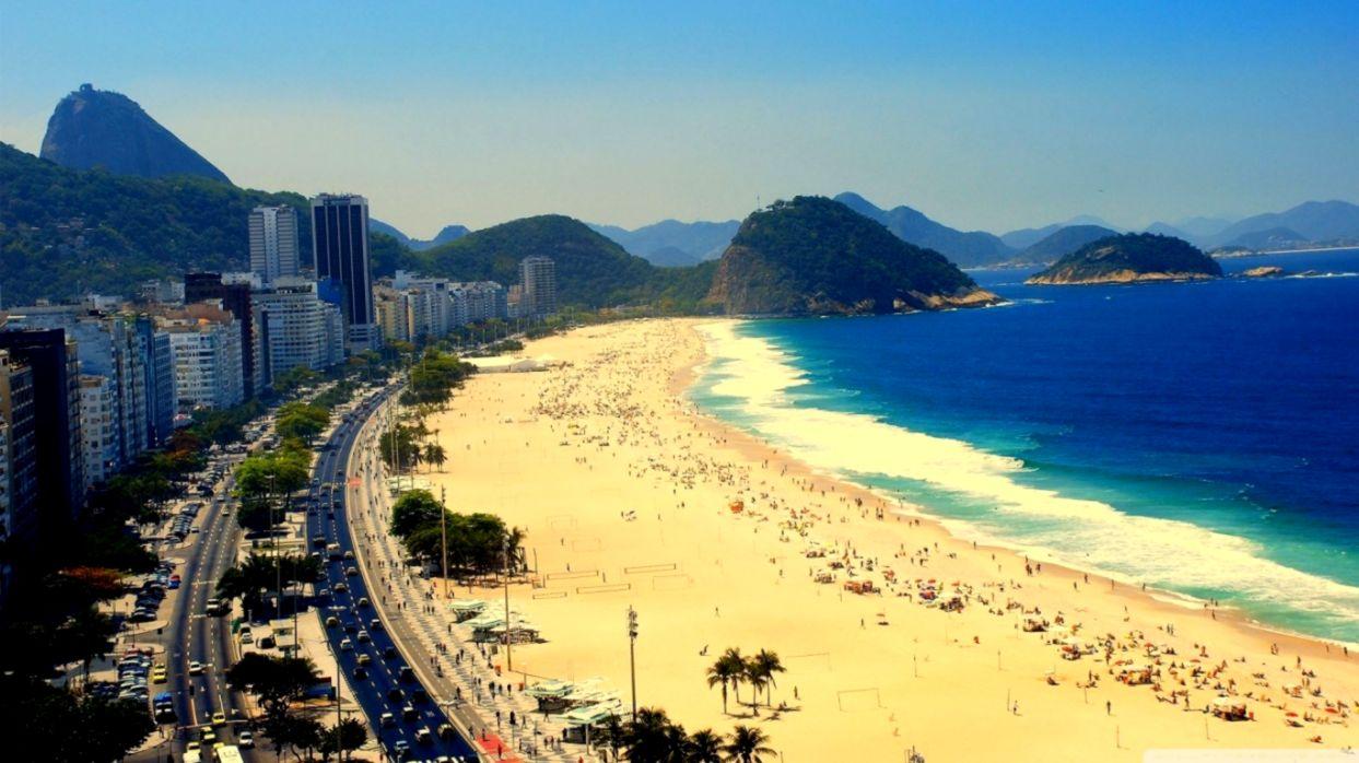 Crowds of people sunbathing on Copacabana Beach in Rio de