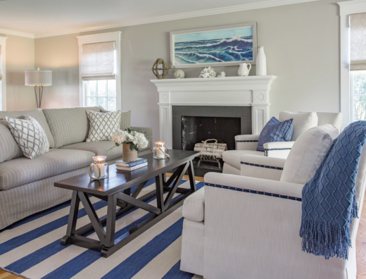 Blue and white striped area rug in coastal living room