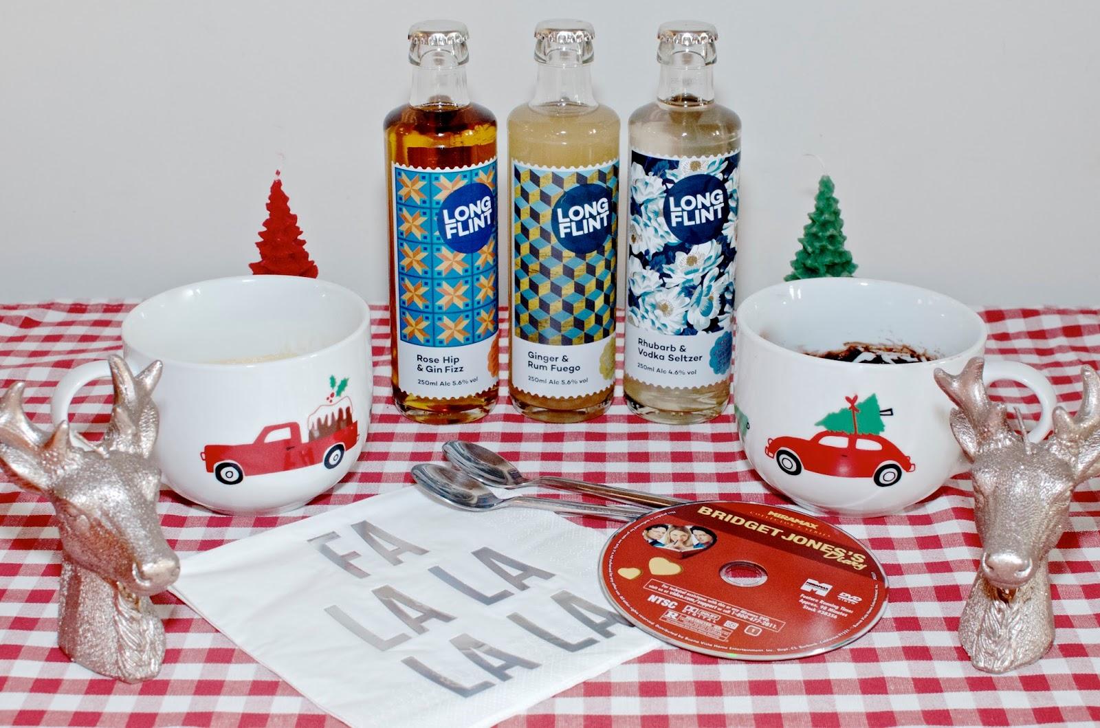 Christmas mugs, reindeer candles, Bridget Jones DVD, napkins and bottled cocktails