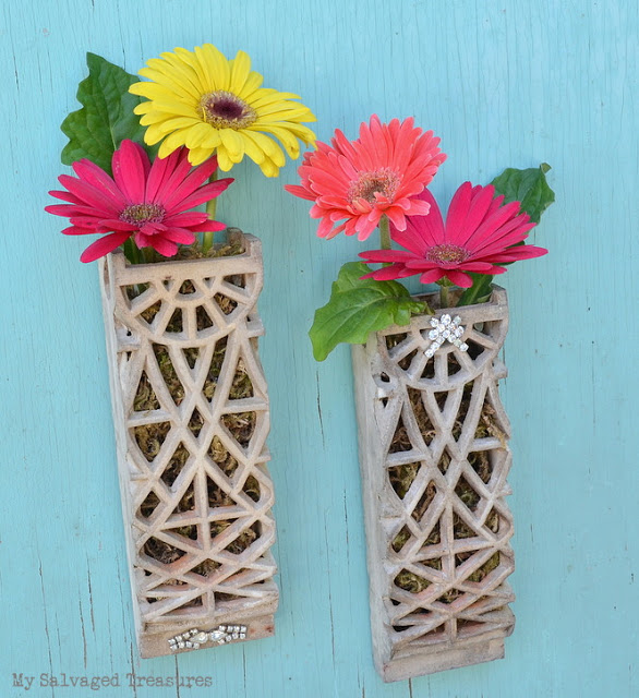 ceramic heater bricks used as wall sconces to hold flowers