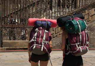 Two ladies travelling with backpacks