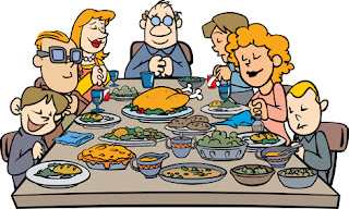 Clipart image of a family saying grace at the Thanksgiving table