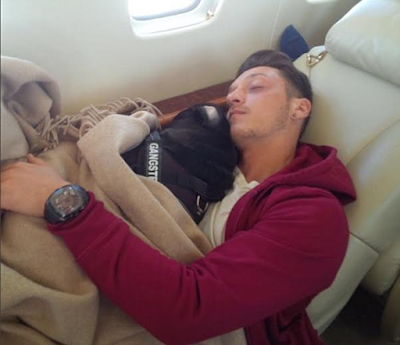 Footballer MESUT oZIL OF aRSENAL AND gERMANY WITH HIS DOG