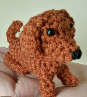 http://www.craftsy.com/pattern/crocheting/toy/teeny-tiny-daschund-amigurumi/104315