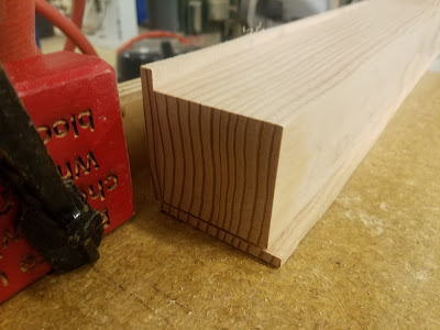 when tapered shims are added, the wooden leg lies square against the cutting table