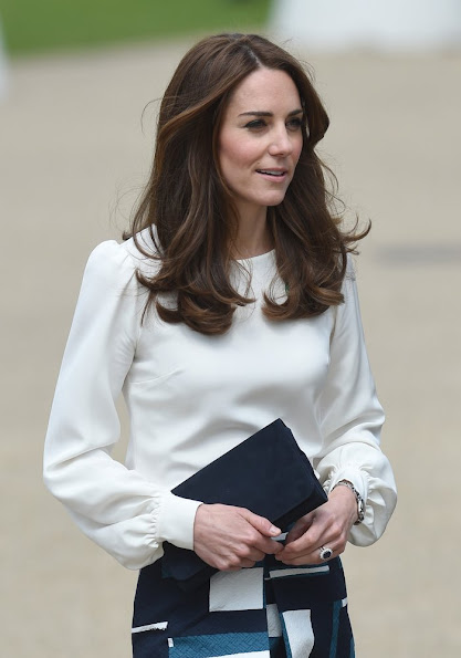 Kate Middleton, Prince William, and Prince Harry attend the official launch of Heads Together. Duchess Catherine wears Banana Republic Geo Jacquard Skirt