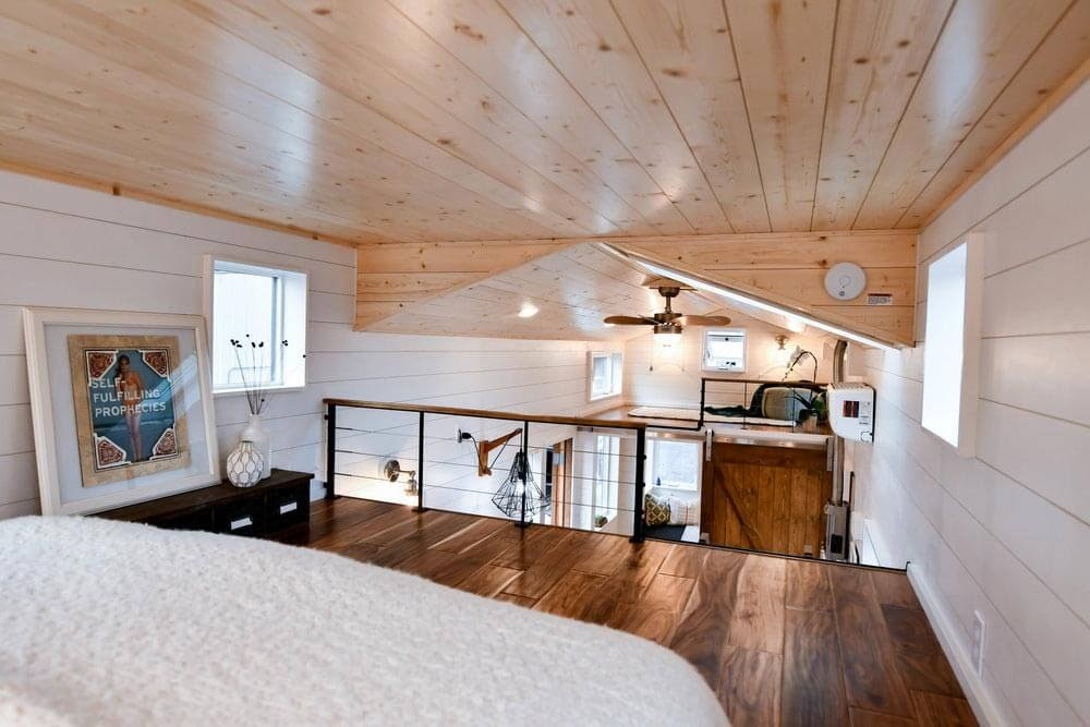 09-Bedroom-Looking-out-Truform-Compact-Architecture-Tiny-House-Living-www-designstack-co
