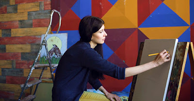Woman artist painting