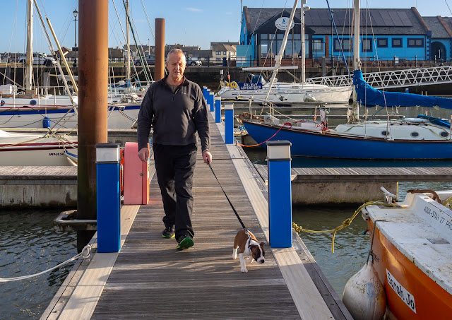 Photo of Phil and Ruby heading back to Ravensdale after a walk on the pontoons