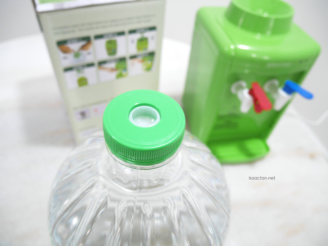 The Spritzer bottle, specially designed with a plug to fit into the dispenser