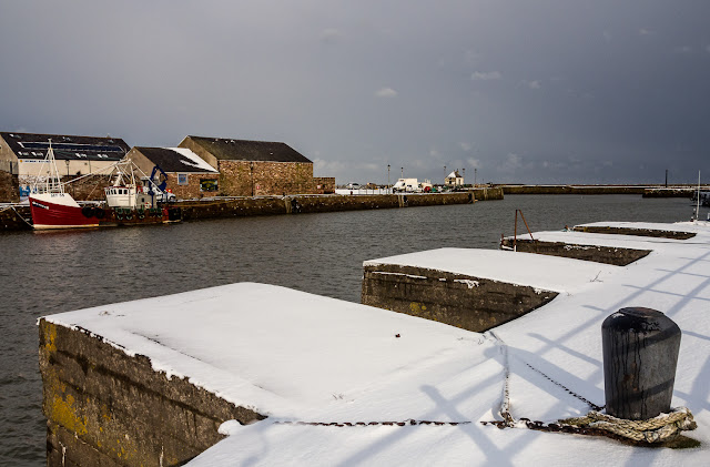 Photo of snow covered docks at Maryport harbour