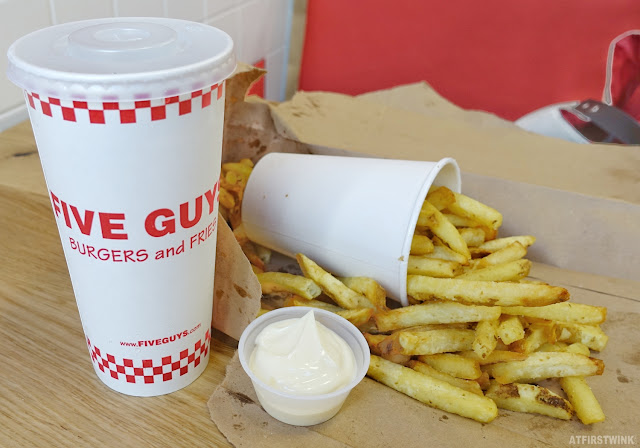 Five Guys restaurant fries unlimited soda cup mayonnaise
