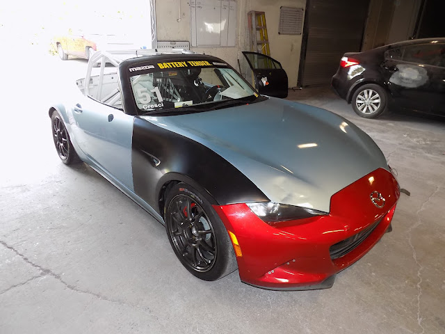 Mazda Miata Race Car before dent repair & overall paint job at Almost Everything Auto Body.