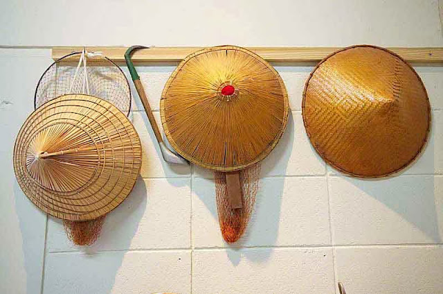 straw hats worn by fishermen