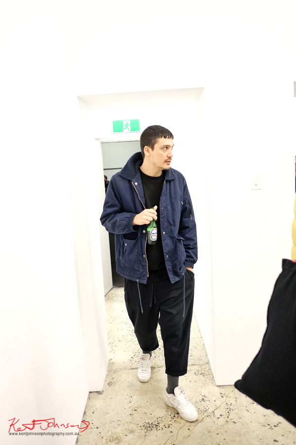 Street fashion Sydney, Blue bomber jacket, black tee and pants.