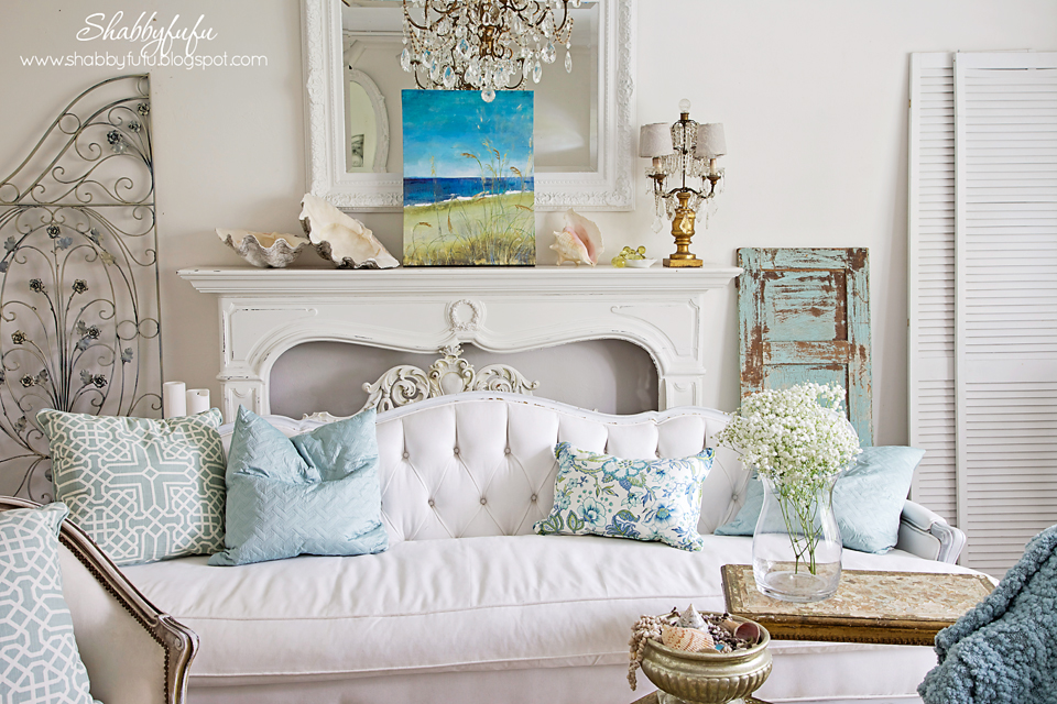 five minute styling tips - coastal colors accent a white room with rustic and vintage artwork