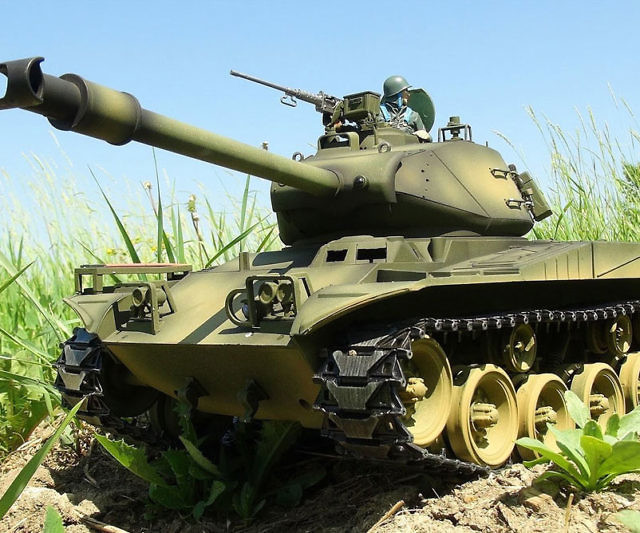 Why settle for a dinky car when you can get behind the controls of this R/C airsoft BB firing battle tank. It comes with a 2000mAh NIMH battery and charger, 2.4GHz transmitter, smoke unit, speaker, and fires 6mm airsoft BBs.