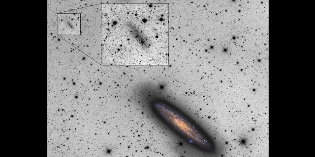 The giant spiral galaxy NGC 253 (shown in color) is accompanied by a newly discovered dwarf galaxy, NGC 253-dw2 (at upper left). The peculiar, elongated shape of the dwarf implies it is being torn apart by the gravity of the bigger galaxy – which in turn shows irregularities on its periphery that may be caused by the mutual interaction. (Image credit: Copyright © 2015 R. Jay GaBany (Cosmotography.com) & Michael Sidonio. Insert image: R. Jay GaBany & Johannes Schedler.)