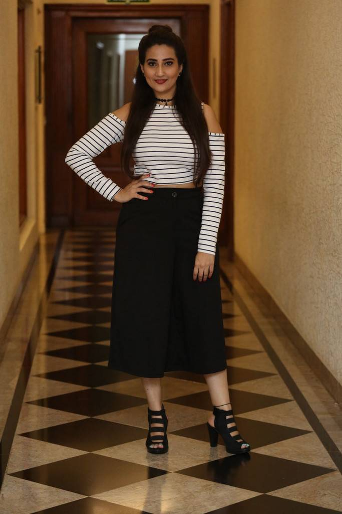 Manjusha In Black Dress At Darshakudu Pre Release Function