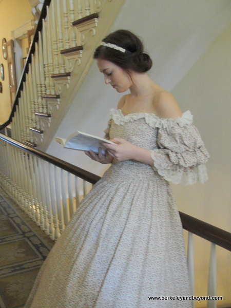reading belle in plantation house at Oak Alley Plantation in Vacherie, Louisiana