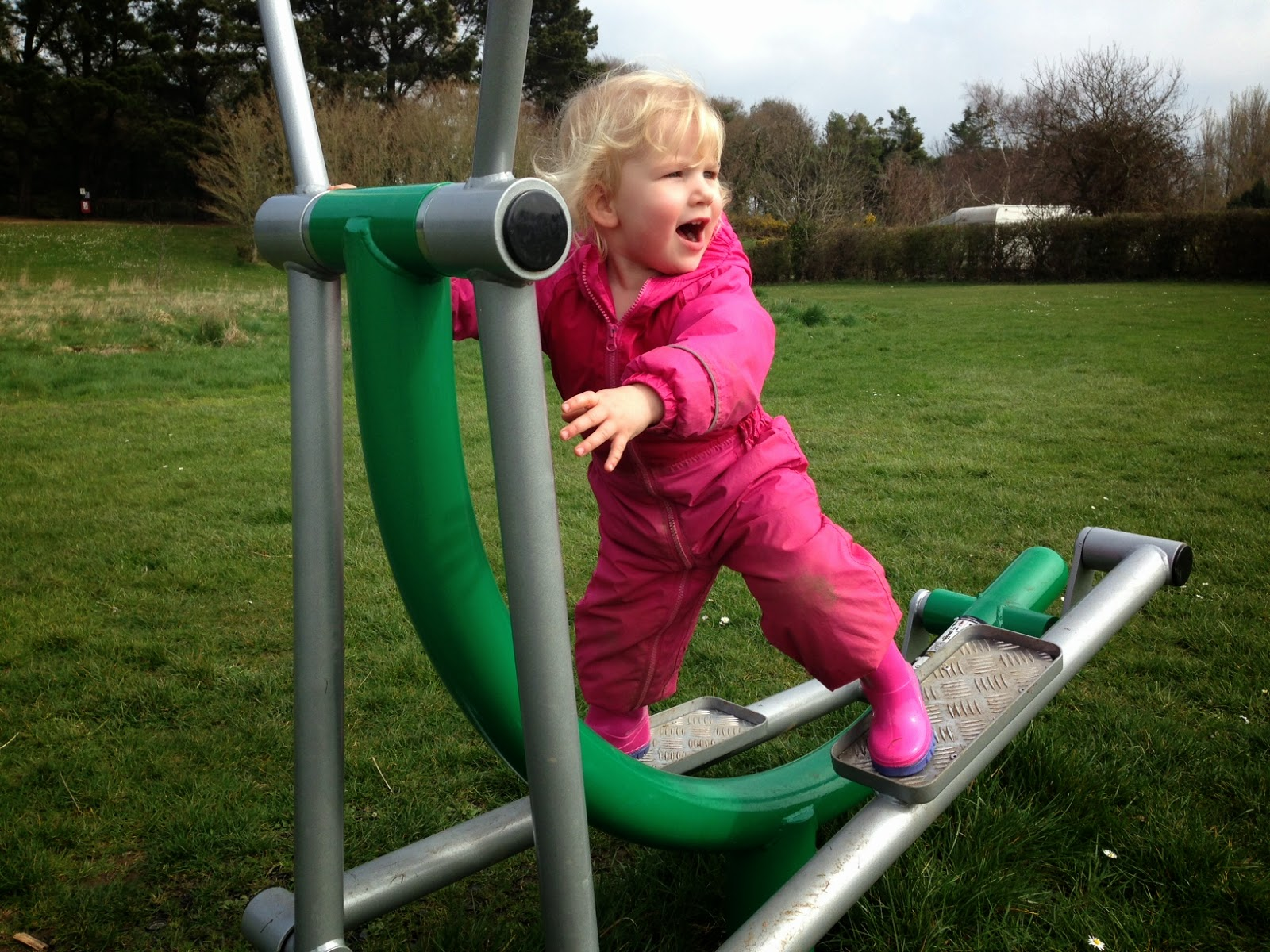 Tin Box Tot on fitness trail exercise equipment