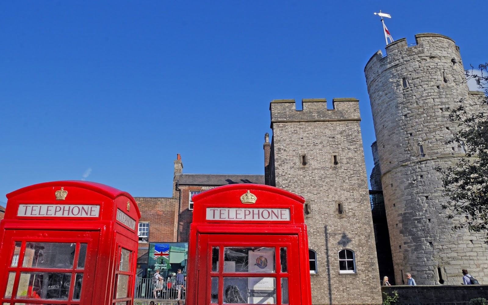 Telephone boxes in front of the Westgate, Canterbury