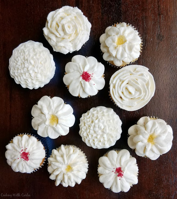 cupcakes with assorted flower designs piped on top