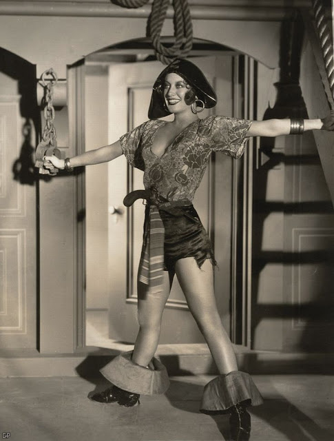 Publicity photo of The Unknown, 1926.  A young Joan Crawford in an exaggerated and risque pirate costume. Freelance Piracy marchmatron.com