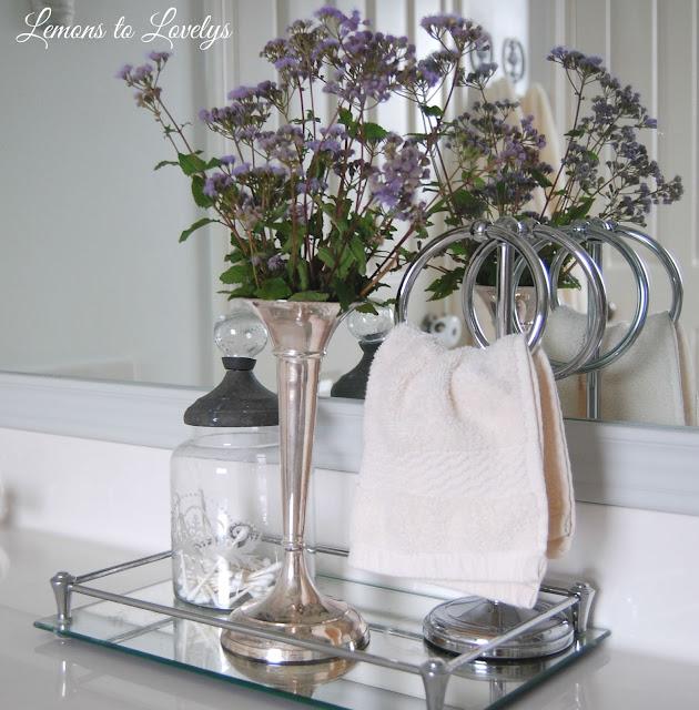 Bathroom vanity & DIY mirror frame .  See more photos at lemonstolovelys.blogspot.com
