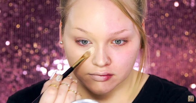 Woman Demonstrates The Power Of Makeup