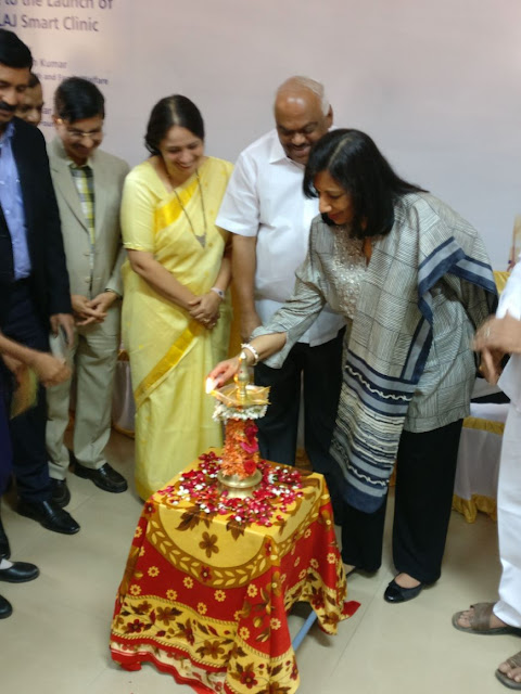 Kiran Mazumdar Shaw lighting the lamp during the eLAJ smart clinic launch