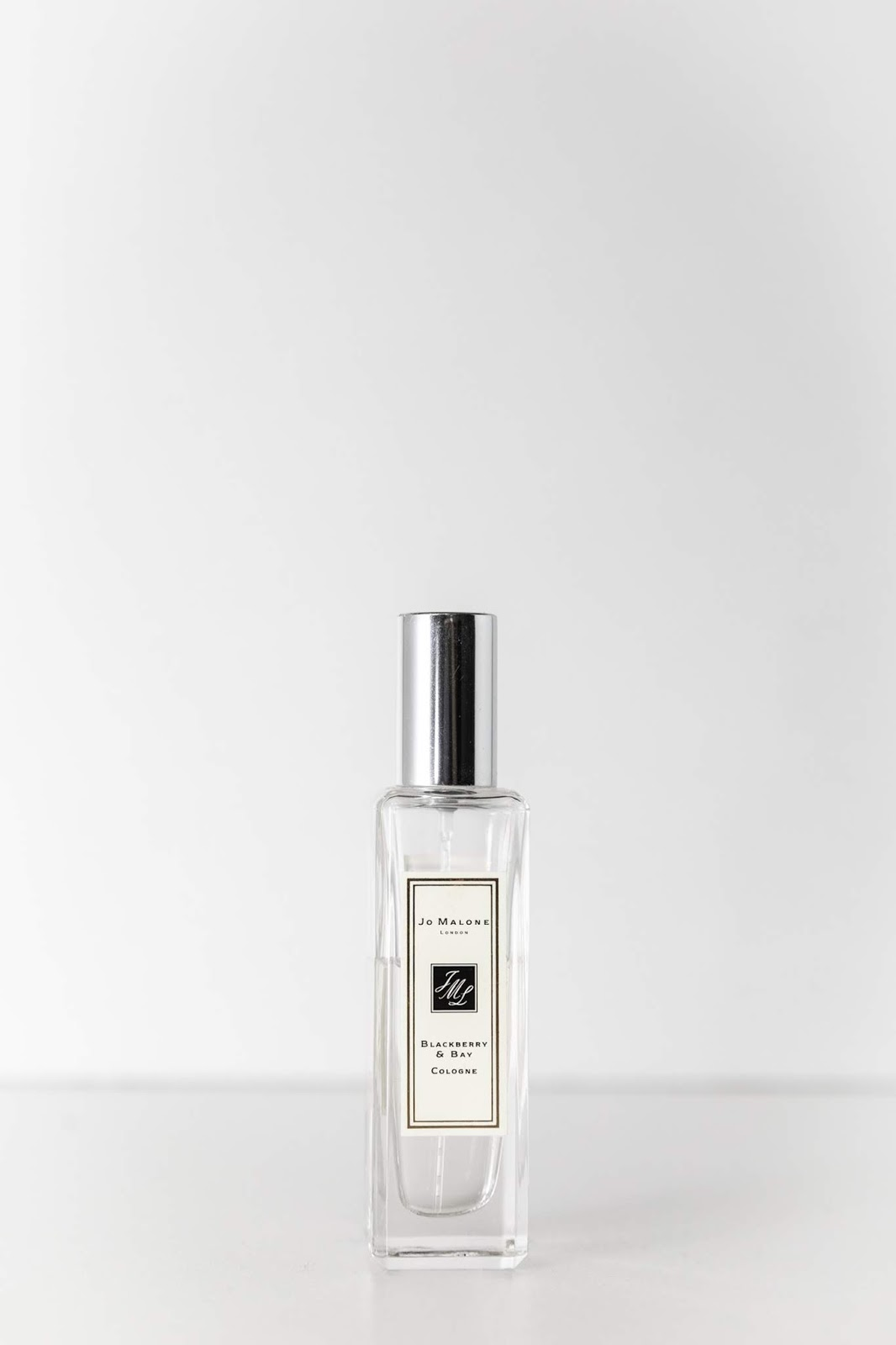 a bottle of jo malone perfume on white background